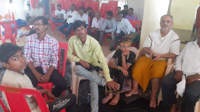 Inmates at the relief camp in Sankeshwar in Hukkeri taluk. (DH Photo)