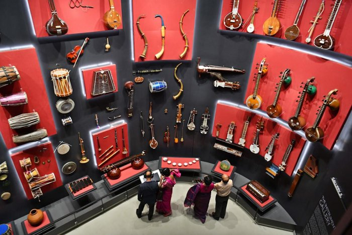 Visitors look at various musical instruments from all over the world at the Indian Music Experience (IME), India's first interactive music museum, in Bengaluru. AFP