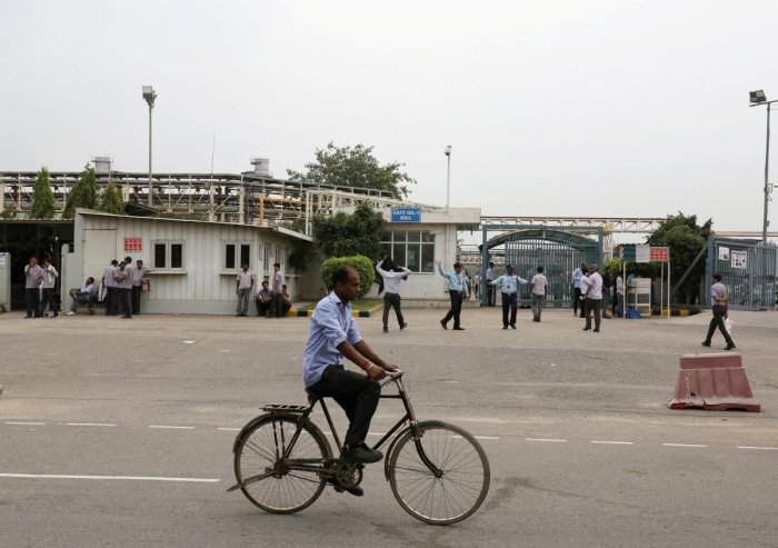 A man rides a bicycle past a Maruti Suzuki India Ltd. manufacturing plant in Manesar in the northern state of Haryana. Reuters file photo for representation.