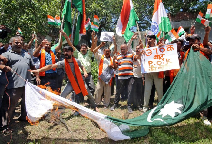 Supporters of Shiv Sena, a Hindu hardline group, burn a flag resembling Pakistan's national flag during a protest in Jammu. Reuters Photo