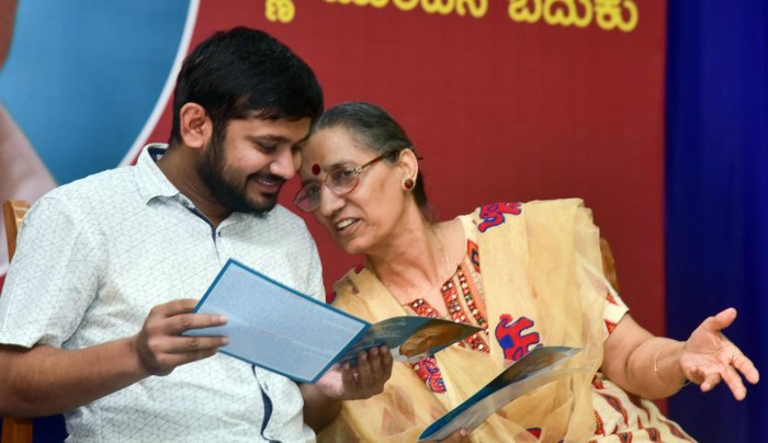 CPI leader Kanhaiya Kumar and AITUC General Secretary Amarjeet Kaur share a lighter moment during the centenary of B V Kakkilaya, in Mangaluru on Saturday.