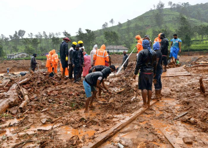 Rescuers remove debris as they search for victims of a landslide caused by torrential monsoon rains in Meppadi in Wayanad district. (Reuters Photo)
