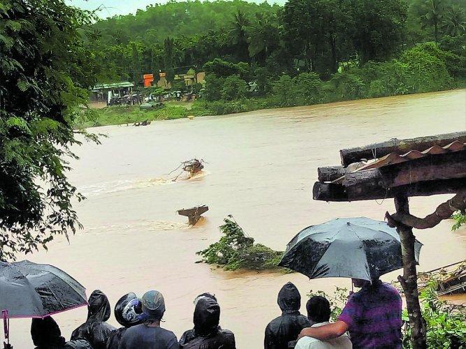 A hanging bridge built across River Nethravathi at Bedrodi near Uppinangady was washed away on Friday night.