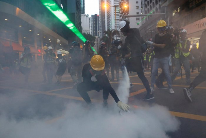 """Protesters hurled bricks at officers and ignored warnings to leave the Sham Shui Po area before tear gas was deployed, police said, calling the march an """"unauthorized assembly."""" (Reuters)"""