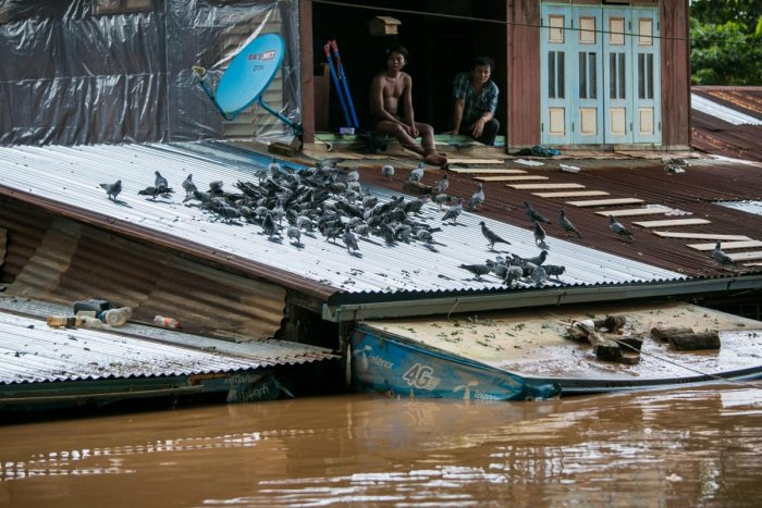 Every year monsoon rains hammer Myanmar and other countries across Southeast Asia, submerging homes, displacing residents and triggering landslides. (AFP Photo)