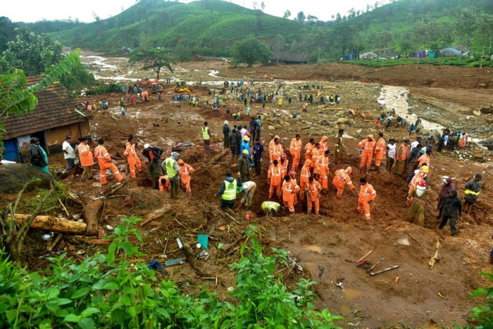 Volunteers, local residents and members of National Disaster Response Force (NDRF) search for survivors in the debris left by a slandslide at Puthumala at Meppadi in the Wayanad district,Kerala. AFP photo