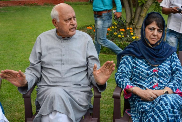 Srinagar: National Conference President Farooq Abdullah and former chief minister and PDP President Mehbooba Mufti during an all parties meeting. (PTI Photo)
