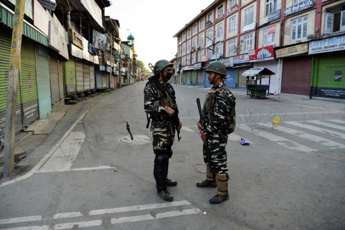 Security personnel stand guard on a street in Srinagar as widespread restrictions on movement and a telecommunications blackout remained in place after the Union government stripped Jammu and Kashmir of its autonomy. AFP