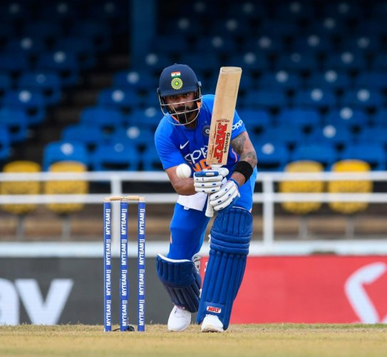 Virat Kohli hits a boundary during the second ODI match between West Indies and India. (AFP photo)