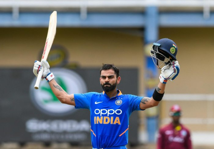 Virat Kohli of India celebrates his century (100 runs) during the 2nd ODI match between West Indies and India at Queens Park Oval in Port of Spain, Trinidad and Tobago. AFP photo