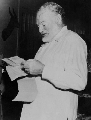 """Ernest Hemingway learning he won the Pulitzer Prize for his novel """"The Old men and the sea"""". (AFP Photo)"""