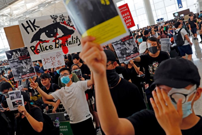 Anti-extradition bill protesters attend a mass demonstration after a woman was shot in the eye during a protest at Hong Kong International Airport, in Hong Kong. Reuters Photo