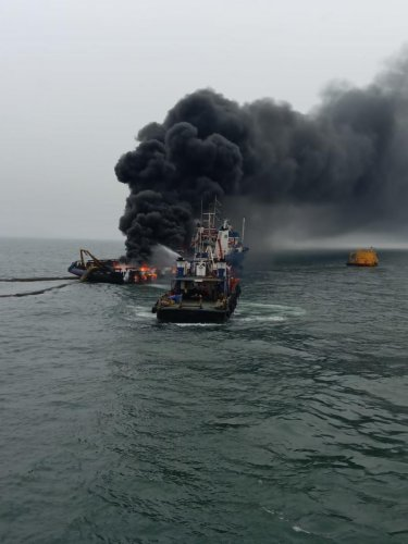 The crew members saved themselves by jumping into the water, abandoning the vessel.