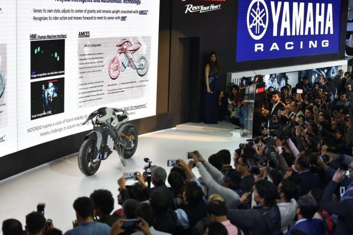 Greater Noida: Visitors take pictures of Yamaha's Motoroid bike during Auto Expo 2018 in Greater Noida on Wednesday. PTI Photo by Vijay Verma (PTI2_7_2018_000080B)