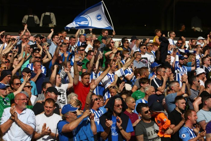 Brighton fans cheer at the end of the English Premier League football match between Wolverhampton Wanderers and Brighton and Hove Albion at the Molineux Stadium in Wolverhampton, central England. (AFP File Photo)