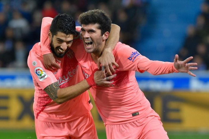 FINE STRIKE: Barcelona's Carles Alena (right) celebrates with Luis Suarez after scoring against Alaves on Tuesday. AFP