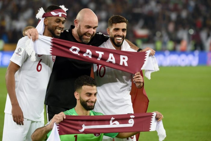 Qatar's coach Felix Sanchez gestures while wearing the gold medal following their win during the 2019 AFC Asian Cup final football match between Japan and Qatar at the Zayed Sports City Stadium. (AFP Photo)
