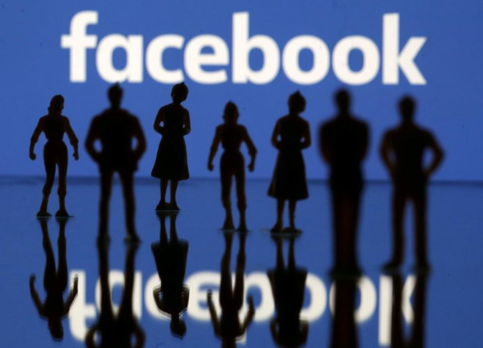 Small toy figures are seen in front of the Facebook logo in this illustration picture, April 8, 2019. (REUTERS File Photo)