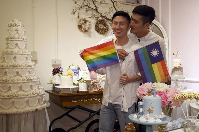 Ccake maker Shane Lin (L) and his lover Marc Yuan posing for a photo during an interview at their workshop Cake Play in Taipei. (Photo by AFP)