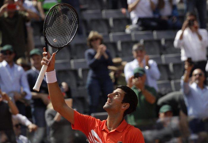 Rome: Serbia's Novak Djokovic celebrates after winning against Canada's Denis Shapovalov at the Italian Open tennis tournament, in Rome. (Photo by PTI)