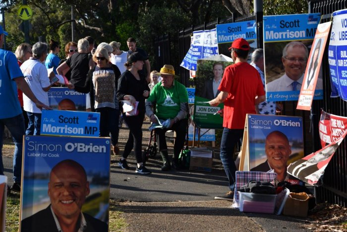 Voters arrive at the Lilly Pilly polling booth to cast their vote during Australia's general election in Sydney. (Photo AFP)