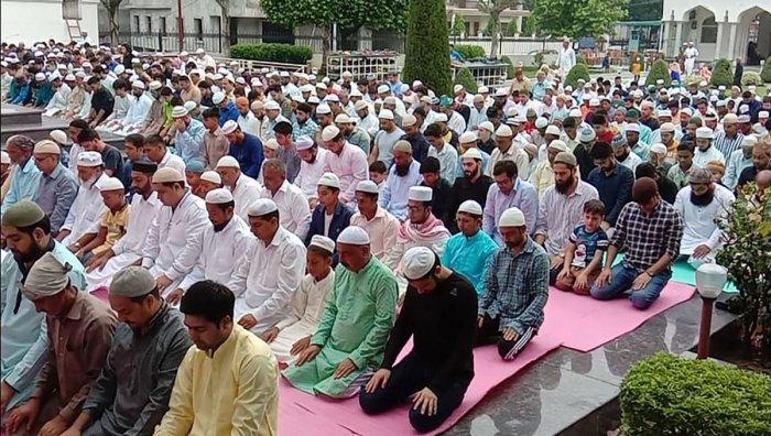 Muslims offer prayers on the occasion of Eid al-Adha, in Srinagar. (PTI Photo)