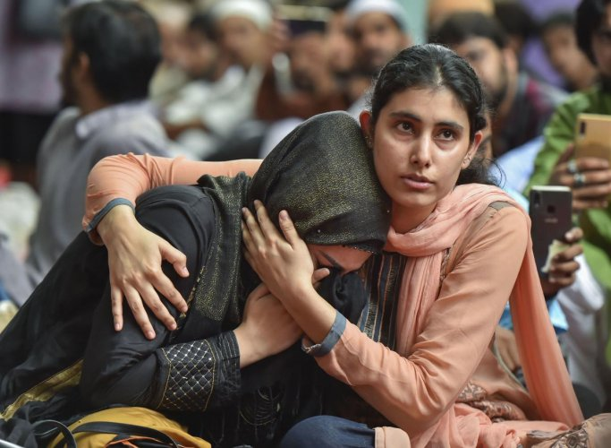 New Delhi: A Muslim woman gets emotional as she celebrates Eid with Kashmiri students who could not reach their families in the wake of abrogation of Article 370 in the state of Jammu and Kashmir, in New Delhi, Monday, Aug 12, 2019. (PTI Photo/Ravi Choudh