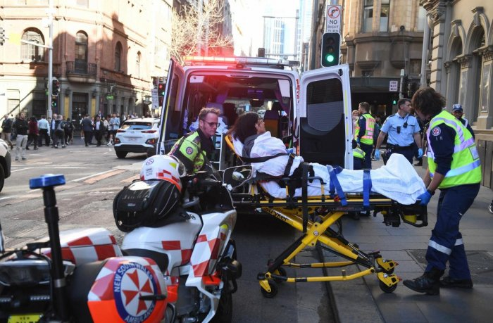 Police and witnesses say a young man yelling about religion and armed with a knife has attempted to stab several people in downtown Sydney before being arrested. AP Photo