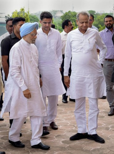 Jaipur: Former prime minister Manmohan Singh with Rajasthan Chief Minister Ashok Gehlot and Dy CM Sachin Pilot arrives to file his nomination papers as a Congress candidate for Rajya Sabha by-election, at the state Assembly in Jaipur, Tuesday, Aug 13, 201