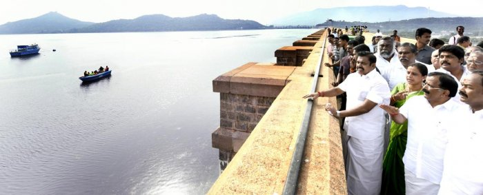 Tamil Nadu Chief Minister Edappadi K Palaniswami at the Stanley Reservoir in Mettur on Tuesday to oversee the opening of sluices of the dam for release of water for irrigation. DH photo