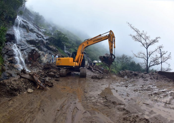 A portion of Charmadi Ghat Road has collapsed after a boulder fell on it.DH Photo/Govindarj Javali