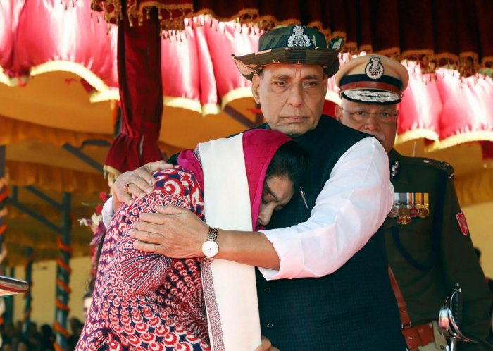 Union Home Minister, Rajnath Singh consoling Manu Sharma, wife of Late CT/GD Sanjeet Kumar, after presenting him with the President's Police Medal for Gallantry (Posthumously), during the 54th Anniversary Parade of the Sashastra Seema Bal (SSB), in New Delhi on Saturday. Director General, SSB, Rajni Kant Mishra is also seen. PTI Photo / PIB for representation.