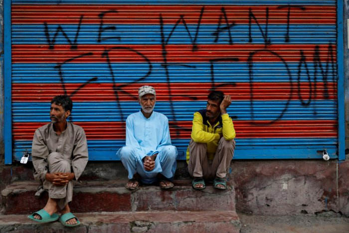 Kashmiri men wait before Eid-al-Adha prayers during restrictions after the scrapping of the special constitutional status for Kashmir by the Indian government, in Srinagar, August 12, 2019. REUTERS/Danish Siddiqui