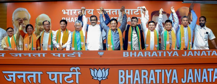 10 Sikkim Democratic Front MLAs join BJP in presence of the party National General Secretary Ram Madhav in New Delhi. (PTI Photo)