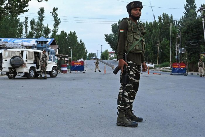 Security personnel stand guard a street during a lockdown in Srinagar on August 12, 2019. (AFP)