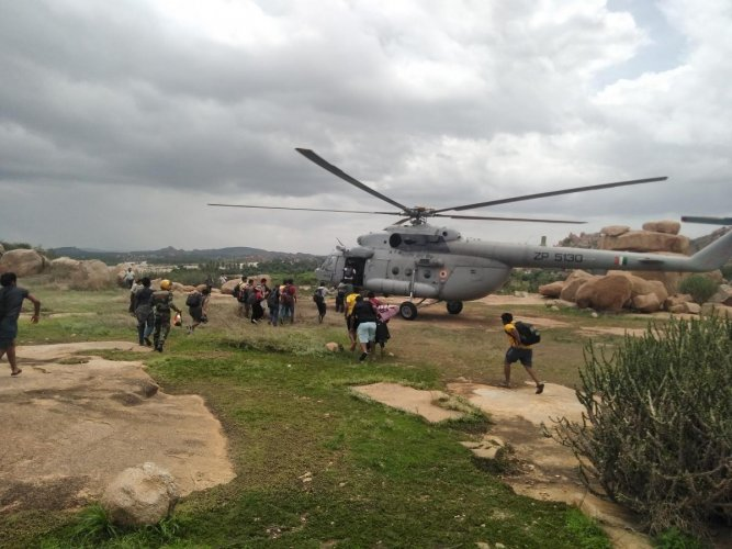 Tourists, who were stranded in Virupapura Gaddi, were rescued with the help of an Army helicopter on Tuesday. DH photo