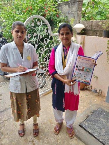 Asha and ANM during a door-to-door awareness campaign.