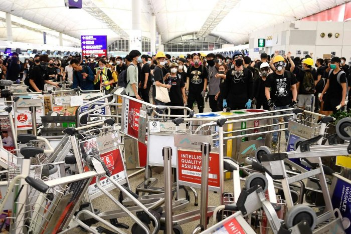 Activists blockaded two terminals in the city on Tuesday in the latest escalation of a 10-week political crisis that has gripped the international finance hub and forced the closure of the airport.