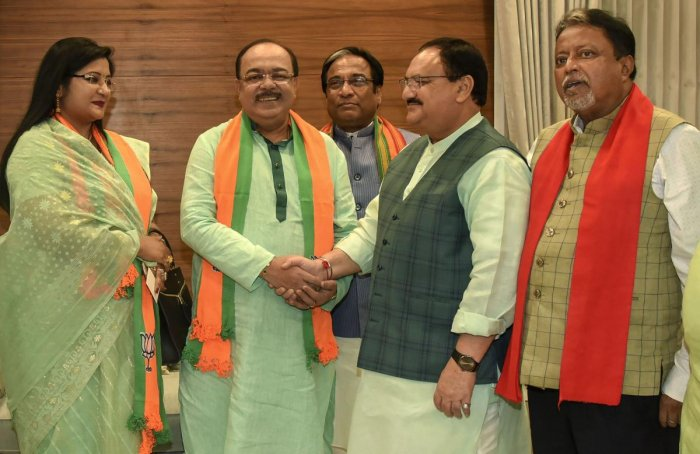 Former Kolkata Municipal Corporation mayor Sovan Chatterjee and his Professor Baisakhi Banerjee join Bharatiya Janata Party in the presence of party's working president J P Nadda, at the BJP HQ in New Delhi. (PTI Photo)