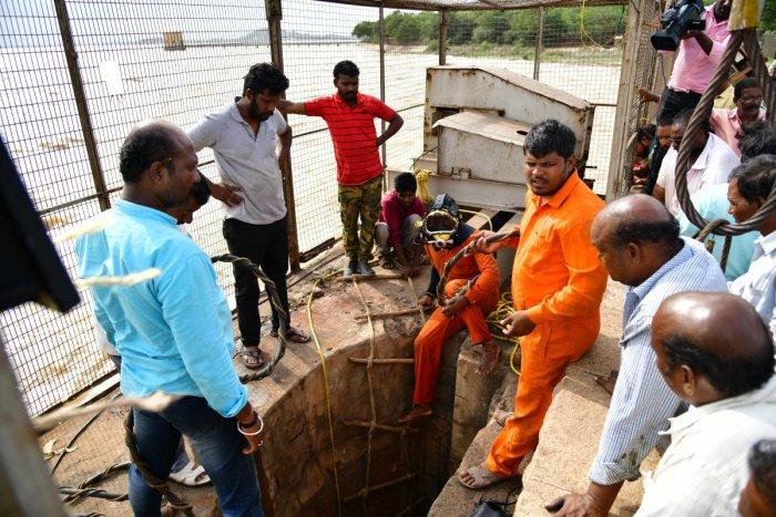 Team fixing the sluice gate snag