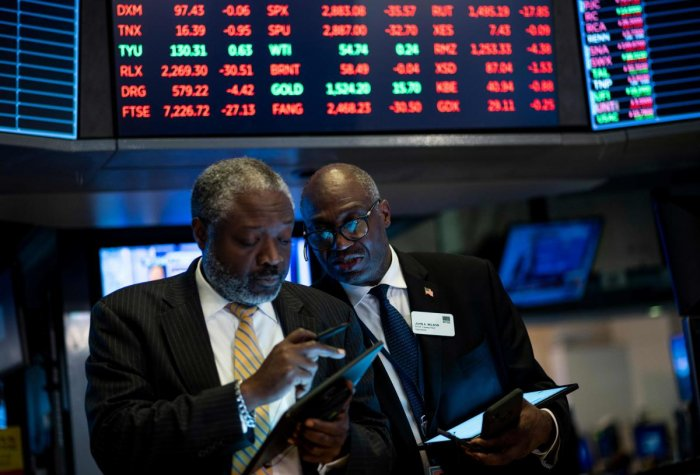 Traders work after the closing bell at the New York Stock Exchange (NYSE) on August 12, 2019 at Wall Street in New York City. - Wall Street stocks finished a bruising session sharply lower as worries about slowing growth and the protracted US-China trade war hit banking shares and the broader market. (Photo by Johannes EISELE / AFP)