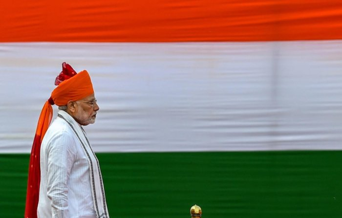 Prime Minister Narendra Modi walks past the tricolour during the 72nd Independence Day at the historic Red Fort, in New Delhi on Wednesday. PTI Photo