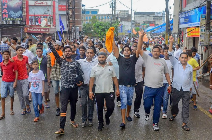 Members of the Dalit community here on Thursday took out a protest march against the demolition of the Guru Ravidas temple in New Delhi. (PTI Photo)