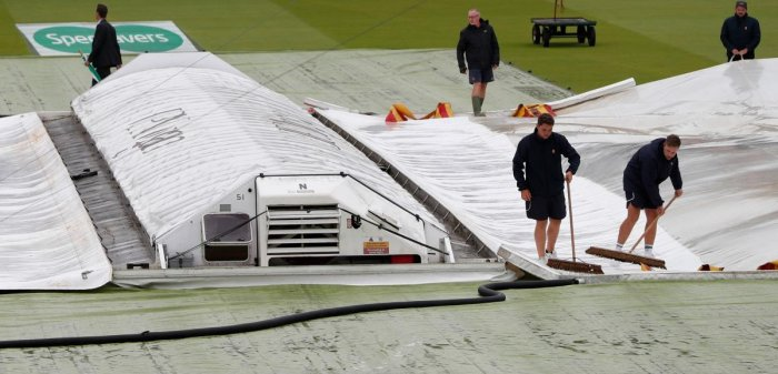 The covers protect the pitch from the rain ahead of play on the first day of the second Ashes cricket Test match between England and Australia at Lord's Cricket Ground in London (AFP Photo)