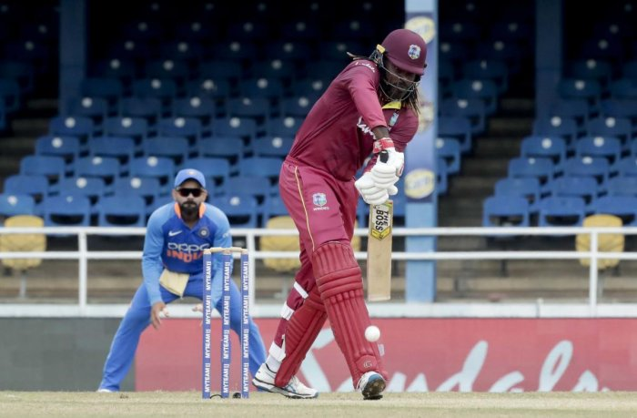 West Indies opening batsman Chris Gayle defends his wicket on the third One-Day International cricket match against India in Port of Spain. (PTI Photo)