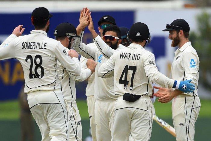 New Zealand's Ajaz Patel (C) celebrates with teammates after dismissing Sri Lanka's Lahiru Thirimanne. (AFP Photo)