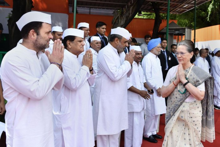 Congress party's interim president Sonia Gandhi greets party leaders as she arrives to hoist the 'tricolour' during 73rd Independence Day celebrations at AICC office, in New Delhi, Thursday, Aug 15, 2019. (PTI Photo) (PTI8_15_2019_000105B)