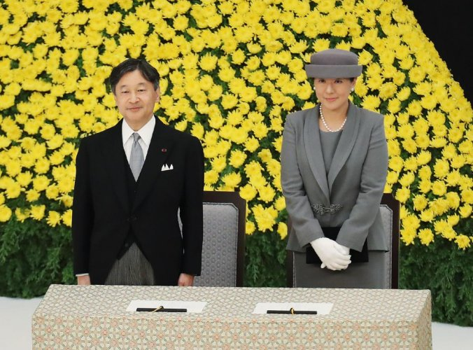 Japan's Emperor Naruhito (L) and Empress Masako (R) attend the annual memorial ceremony to remember those lost at war, on August 15, 2019, in Tokyo as the country marks the 74th anniversary of its surrender in World War II. (Photo by JIJI PRESS / JIJI PRE