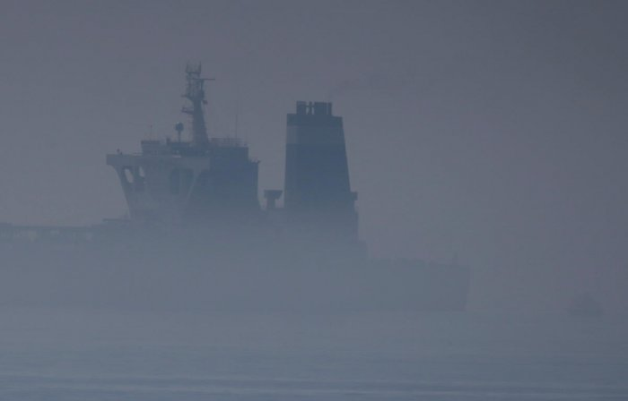 Iranian oil tanker Grace 1 sits anchored in the fog after it was seized in July by British Royal Marines off the coast of the British Mediterranean territory on suspicion of violating sanctions against Syria, in the Strait of Gibraltar, southern Spain Aug