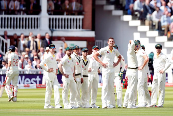 Australia's Josh Hazlewood and teammates watch the replay after taking the wicket of England's Joe Root. (Reuters Photo)